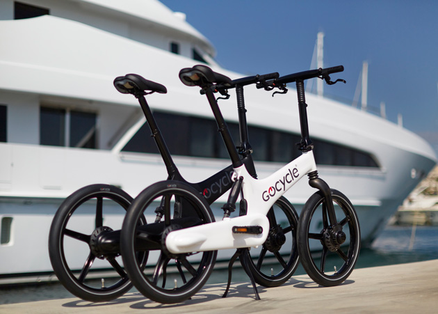 Gocycle alongisde luxury yacht