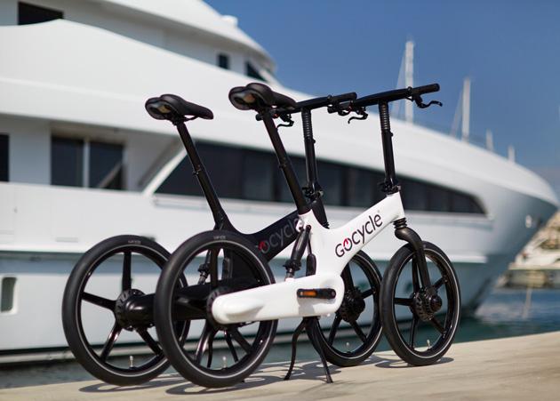 Gocycle alongisde luxury yacht